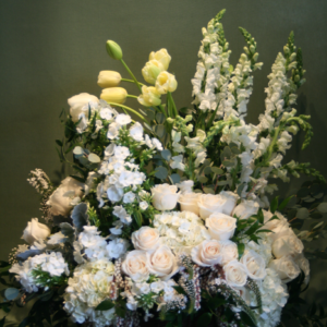 large all white flower arrangement in a basket